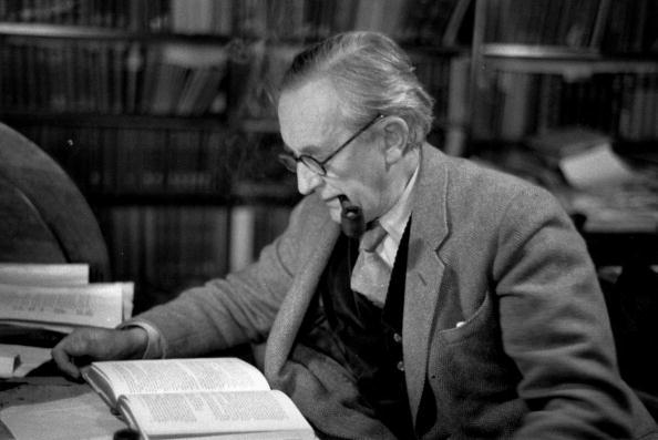 2nd December 1955:  John Ronald Reuel Tolkien (1892 - 1973), British writer and professor at Merton College Oxford, reading in his study. Original Publication: Picture Post - 8464 - Professor J R R Tolkien - unpub.  (Photo by Haywood Magee/Picture Post/Getty Images)